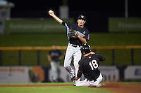 Wisconsin Timber Rattlers shortstop Blake Allemand (6) throws to first as Trent Woodward (18) slides in during the second game of a doubleheader against the Quad Cities River Bandits on August 19, 2015 at Modern Woodmen Park in Davenport, Iowa.  Quad Cities defeated Wisconsin 8-1.  (Mike Janes/Four Seam Images)
