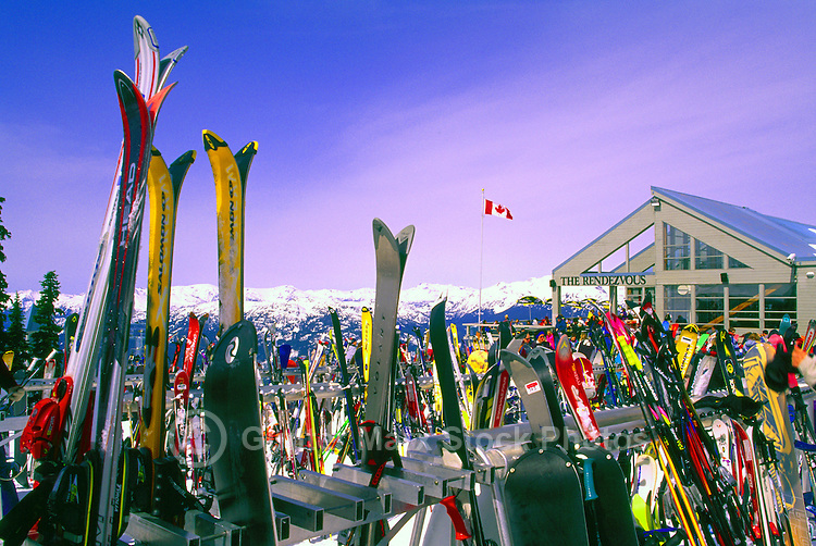 Downhill Skis and Snowboards leaning against Ski Racks at The Rendezvous Day Lodge, on Blackcomb Mountain at Whistler Resort, in the Coast Mountains, Whistler, British Columbia, Canada