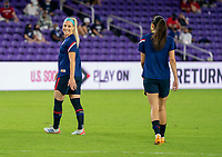 ORLANDO, FL - FEBRUARY 24: Julie Ertz #8 and Christen Press #23 of the USWNT warm up before a game between Argentina and USWNT at Exploria Stadium on February 24, 2021 in Orlando, Florida.