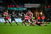 Friday 03 January 2014<br /> Pictured:Aisea Natoga ( with ball ) bakes a run at the Scarlets<br /> Re: Ospreys v Scarlets, Rabo Direct Pro 12 match at the Liberty Stadium Swansea, Wales