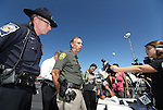 Carson City Sheriff Ken Furlong, center, and Trooper Chuck Allen, answer media questions following a shooting in an IHOP restaurant in Carson City, Nev., on Tuesday, Sept. 6, 2011. Three people were killed and six injured in the attack and the gunman has died from an apparent self-inflicted gunshot wound.  (AP Photo/Cathleen Allison)