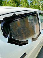 "Pictured: The white Suzuki car police had to take off the road after found to have been patched up with gaffer tape in Merlin's Bridge, Wales, UK.<br /> Re: A car has been taken off the roads after the driver rolled the vehicle and patched it up with tape.<br /> The driver told the officers from the Pembrokeshire Road Policing Unit he had rolled the car while driving it around fields.<br /> A spokesman for the police said: ""Such repairs do not make it roadworthy.""<br /> A prohibition was issued on the vehicle in Merlins Bridge, west Wales."