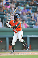 Second baseman Giovanny Alfonzo (7) of the Greensboro Grasshoppers bats in a game against the Greenville Drive on Thursday, July 14, 2016, at Fluor Field at the West End in Greenville, South Carolina. (Tom Priddy/Four Seam Images)
