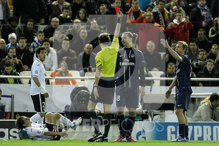 Italia's referee Paolo Tagliavento show the red card to Zlatan Ibrahimovic in presence of Valencia CF's Daniel Parejo (l) and Andres Guardado injured and Paris Saint-Germain's Gregory Van der Wiel during Champions League 2012/2013 match.February 12,2013. (ALTERPHOTOS/Acero)