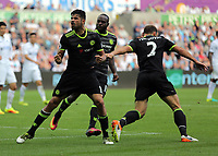 Diego Costa of Chelsea celebrates his second goal which he scored with a bicycle kick during the Premier League match between Swansea City and Chelsea at The Liberty Stadium on September 11, 2016 in Swansea, Wales.