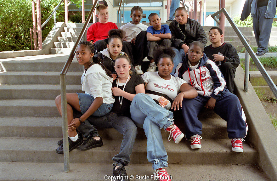 Middle School Students stike laid-back pose for the photographer.