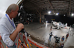 "Staff Photo/Mike Ullery.Dayton resident and internationally known aviation photographer Dan Patterson photographs one of the many P-51 Mustangs in attendance at the Gathering of Mustangs and Legends at Rickenbacker Air National Guard Base near Columbus. Patterson is doing studio ""portraits"" of each Mustang that arrives at the event."