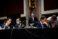 United States Senator Josh Hawley (Republican of Missouri), left, and United States Senator Ben Sasse (Republican of Nebraska), second from right, confer with aides at a US Senate Judiciary Committee business meeting to consider authorization for subpoenas relating to the Crossfire Hurricane investigation and other matters on Capitol Hill in Washington, DC on June 11, 2020.<br /> Credit: Erin Schaff / Pool via CNP/AdMedia