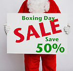Santa Claus holding Boxing Day sale sign