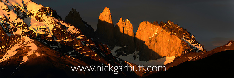 Dramatic light at sunrise on the Towers and Central Massif of Torres del Paine. Torres del Paine National Park, Patagonia, Chile.