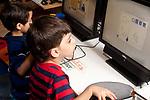Education preschool computer activity boys playing educational games on desktop computers