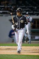 Carlos Sanchez (13) of the Charlotte Knights walks back to the dugout after striking out against the Toledo Mud Hens at BB&T BallPark on April 27, 2015 in Charlotte, North Carolina.  The Knights defeated the Mud Hens 7-6 in 10 innings.   (Brian Westerholt/Four Seam Images)