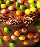 Try Skittles or other colorful candy if you're not adept at traditional cake decorating. This is an example of Devils food cake strewn with Skittles at Piece of Cake bakery. Photo by Brad Stauffer