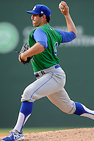 Relief pitcher Kenny Swab (4) of the Lexington Legends in a game against the Greenville Drive on Sunday, April 27, 2014, at Fluor Field at the West End in Greenville, South Carolina. Greenville won, 21-6. (Tom Priddy/Four Seam Images)