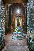 Cambodia.  Preah Khan Ruins.  Stupa in Central Sanctuary.  Offerings show that this is still a place of pilgrimage and worship.  12th. Century.