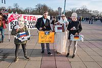 """Menschenrechtsaktion der Gesellschaft fuer bedrohte Voelker (GfbV) vor dem Laenderspiel Deutschland-Brasilien. Unter dem Motto """"FIFA: Keine Spiele fuer Diktatoren –Menschenrechte staerker beruecksichtigen!"""" protestierte die GfbV am Dienstag den 27. Maerz 2018 vor dem Berliner Olympiastadion gegen die Vergabe von Weltmeisterschaften an Diktaturen wie Russland oder Katar. Die Organisation fordert """"dass bei der Vergabe der Turniere Menschenrechte zukuenftig eine groessere Rolle spielen muessen. Wer Meinungs- und Pressefreiheit mit Fuessen tritt, willkuerlich verhaften und foltern laesst und beim Bau von Stadien massiv Menschenrechte verletzt, disqualifiziert sich selbst als Austragungsort fuer WM-Turniere.""""<br /> Im Bild: """"WM zu verkaufen"""" - Teilnehmer der Aktion haben sich vlnr. als Russischer Praesident Putin, als Autionator, als Scheich Al Thani aus Katar und als Franz Beckenbauer aus Deutschland verkleidet.<br /> 27.1.2018, Berlin<br /> Copyright: Christian-Ditsch.de<br /> [Inhaltsveraendernde Manipulation des Fotos nur nach ausdruecklicher Genehmigung des Fotografen. Vereinbarungen ueber Abtretung von Persoenlichkeitsrechten/Model Release der abgebildeten Person/Personen liegen nicht vor. NO MODEL RELEASE! Nur fuer Redaktionelle Zwecke. Don't publish without copyright Christian-Ditsch.de, Veroeffentlichung nur mit Fotografennennung, sowie gegen Honorar, MwSt. und Beleg. Konto: I N G - D i B a, IBAN DE58500105175400192269, BIC INGDDEFFXXX, Kontakt: post@christian-ditsch.de<br /> Bei der Bearbeitung der Dateiinformationen darf die Urheberkennzeichnung in den EXIF- und  IPTC-Daten nicht entfernt werden, diese sind in digitalen Medien nach §95c UrhG rechtlich geschuetzt. Der Urhebervermerk wird gemaess §13 UrhG verlangt.]"""