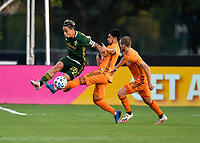 LAKE BUENA VISTA, FL - JULY 18: Pablo Bonilla #28 of the Portland Timbers battles for the ball with Memo Rodríguez #8 of the Houston Dynamo during a game between Houston Dynamo and Portland Timbers at ESPN Wide World of Sports on July 18, 2020 in Lake Buena Vista, Florida.