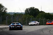 #57 Heinricher Racing w/MSR Curb-Agajanian Acura NSX GT3, GTD: Alvaro Parente, Misha Goikhberg, #63 Scuderia Corsa Ferrari 488 GT3, GTD: Cooper MacNeil, Toni Vilander