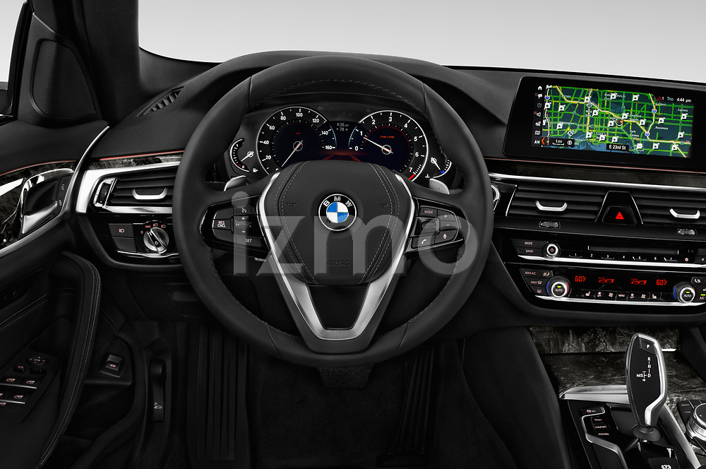Car pictures of steering wheel view of a 2019 BMW 5 Series 540i Sport Line 4 Door Sedan