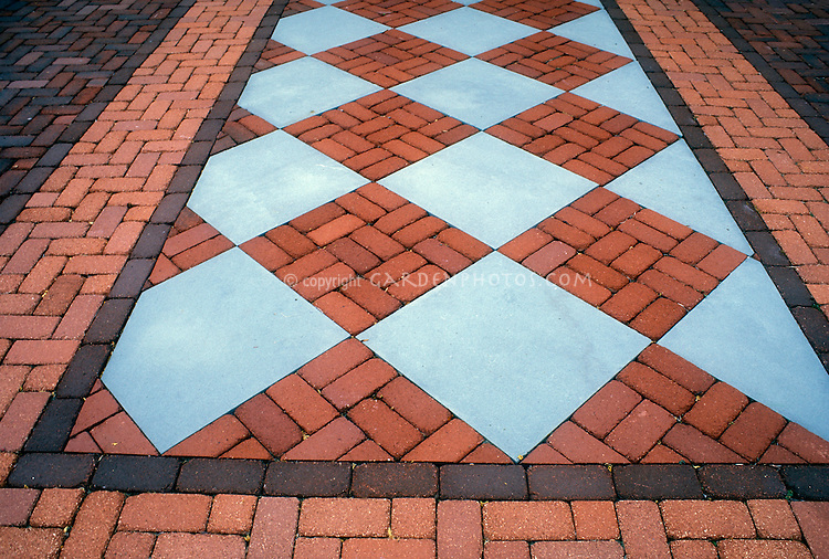 Patio of brick and bluestone pavers in ornamental pattern