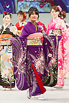 February16, 2013, Tokyo, Japan - A contestant shows off her kimono on stage during the 2013 Kimono Queen Contest. Approximately 500 women dressed in beautifully designed kimonos participate in this annual event for a chance to win special prizes and given the opportunity to be recognized as a kimono model in various media outlets. (Photo by Christopher Jue/Nippon News)