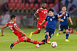 Minamino Takumi of Japan (R) is tackled by Mohammed Al Musallami of Oman (L) during the AFC Asian Cup UAE 2019 Group F match between Oman (OMA) and Japan (JPN) at Zayed Sports City Stadium on 13 January 2019 in Abu Dhabi, United Arab Emirates. Photo by Marcio Rodrigo Machado / Power Sport Images