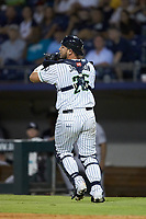 Gwinnett Stripers catcher Alex Jackson (25) catches a foul pop fly during the game against the Scranton/Wilkes-Barre RailRiders at Coolray Field on August 17, 2019 in Lawrenceville, Georgia. The Stripers defeated the RailRiders 8-7 in eleven innings. (Brian Westerholt/Four Seam Images)