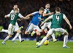 Martyn Waghorn powers past the Hibs rearguard