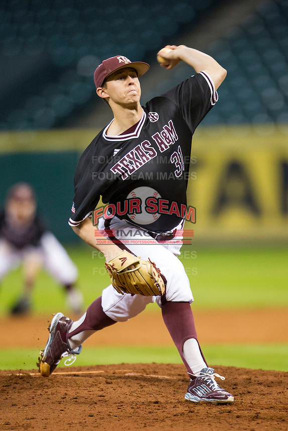 Texas A&M Aggies pitcher Matt Kent (31) delivers a pitch to the plate during the Houston College Classic against the Baylor Bears on March 8, 2015 at Minute Maid Park in Houston, Texas. Texas A&M defeated Baylor 3-2. (Andrew Woolley/Four Seam Images)