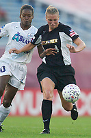 Lauren Orlandos of the Power and Charmaine Hooper of the Beat both go for the ball. The Atlanta Beat and the NY Power played to a 1-1 tie on 7/26/03 at Mitchel Athletic Complex, Uniondale, NY.