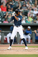 Right fielder Jose Medina (12) of the Columbia Fireflies bats in a game against the Lexington Legends on Friday, May 3, 2019, at Segra Park in Columbia, South Carolina. Lexington won, 5-2. (Tom Priddy/Four Seam Images)