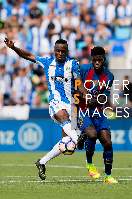 Mamadou Kone of Deportivo Leganes battles for the ball with Samuel Umtiti of FC Barcelona during their La Liga match between Deportivo Leganes and FC Barcelona at the Butarque Municipal Stadium on 17 September 2016 in Madrid, Spain. Photo by Diego Gonzalez Souto / Power Sport Imagesas