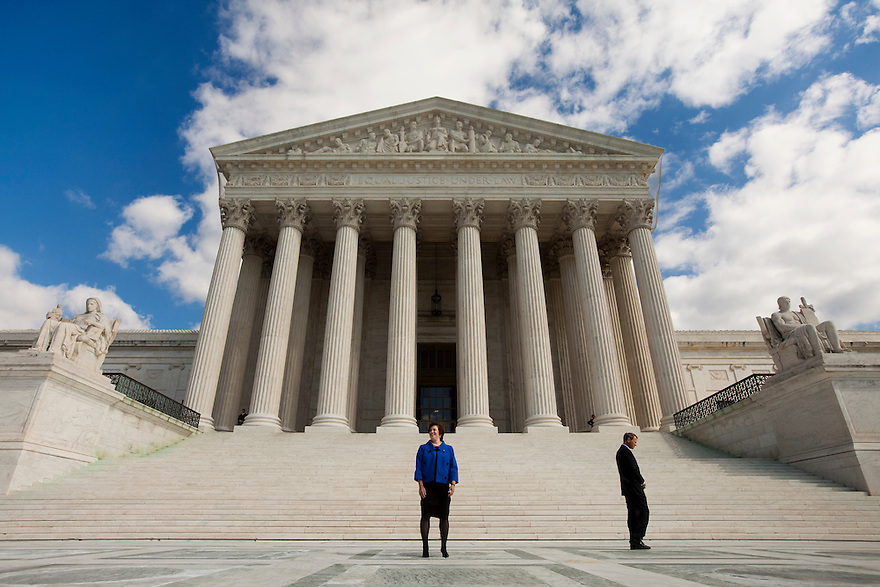 Justice Elena Kagan with Chief Justice of the United States John Roberts following her formal investiture ceremony at the Supreme Court in Washington.