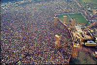 """BNPS.co.uk (01202 558833)<br /> Pic: BarryLevine/Guernseys/BNPS<br /> <br /> !!!ONE TIME USE ONLY!!! PICS ONLY TO BE USED IN RELATION TO THE AUCTION!!!<br /> <br /> Pictured: An aerial photograph of Woodstock Festival.<br /> <br /> A photo collection offering a rare glimpse of the iconic Woodstock Festival has sold for over £12,000.<br /> <br /> The unique Levine series captured some of the world's most famous rock stars performing at the one-of-a-kind festival in Bethel, New York, in August 1969, including Jimi Hendrix, Janis Joplin, The Who, and Neil Young.<br /> <br /> Barry Levine, now 77, brushed shoulders with many of his subjects, recalling Hendrix's """"amazing sense of humour"""" and Young's disdain for photographers from his home in Florida."""