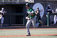 CARY, NC - FEBRUARY 23: Freddy Sabido #33 of Wagner College reacts while scoring the go ahead run in the top of the eleventh inning during a game between Wagner and Penn State at Coleman Field at USA Baseball National Training Complex on February 23, 2020 in Cary, North Carolina.