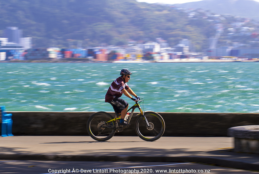 People cycle along Oriental Parade on Easter Monday during lockdown for the COVID19 pandemic in Wellington, New Zealand on Monday, 13 April 2020. Photo: Dave Lintott / lintottphoto.co.nz