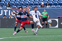 FOXBOROUGH, MA - JULY 4: Alex Morrell #7 of Greenville Triumph SC passes the ball under pressure from Pierre Cacet #44 of the New England Revolution II during a game between Greenville Triumph SC and New England Revolution II at Gillette Stadium on July 4, 2021 in Foxborough, Massachusetts.