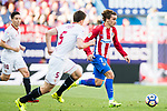 Antoine Griezmann (r) of Atletico de Madrid fights for the ball with Clement Lenglet of Sevilla FC during their La Liga match between Atletico de Madrid and Sevilla FC at the Estadio Vicente Calderon on 19 March 2017 in Madrid, Spain. Photo by Diego Gonzalez Souto / Power Sport Images