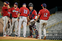 Fort Myers Miracle relief pitcher Calvin Faucher (12) walks towards the dugout while talking with catcher Ben Rortvedt (15) after a pitching change during a Florida State League game against the Bradenton Marauders on April 23, 2019 at LECOM Park in Bradenton, Florida.  Fort Myers defeated Bradenton 2-1.  (Mike Janes/Four Seam Images)
