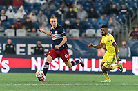 FOXBOROUGH, MA - AUGUST 4: Adam Buksa #9 of New England Revolution brings the ball forward as Anibal Godoy #20 of Nashville SC closes during a game between Nashville SC and New England Revolution at Gillette Stadium on August 4, 2021 in Foxborough, Massachusetts.