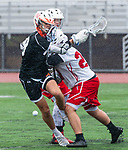 WOLCOTT, CT 050521JS03—Watertown's Mason Smutney (18) looses the ball after getting hit by Wolcott's Tyler Paquet (24) during their game Wednesday at Wolcott High School.<br /> Jim Shannon Republican American