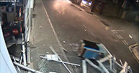 "Pictured: CCTV still showing a Mitsubishi 4x4 pulling out a cashpoint from the Co-op store in Treharris, Wales, UK. 14 May 2019<br /> Re: Blundering ram raiders who escaped with an ATM machine containing £80,000 unaware it was fitted with a secret tracking device, have been jailed for a total of twenty years by Merthyr Tydfil Crown Court.<br /> The masked gang took the cash machine to a deserted farmhouse where a security monitoring company picked up its GPS signals.<br /> The money was being ""divvied up"" when police swooped to arrest the five gang members and seize a bin bag packed with £20 and £10 notes<br /> A jury was shown dramatic video of the gang reversing a 4X4 vehicle into a Valleys Co-op store in the early hours.<br /> Prosecutor Alex Greenwood said: ""The peace of Treharris village was interrupted by an audacious criminal enterprise.<br /> ""It was a highly-organised burglary to remove the ATM from the Co-op store.<br /> ""A masked criminal gang reversed a Mitsubishi pick-up into the front of the shop. <br /> ""Straps were attached to the machine and the pick-up drove off dragging it down the street with sparks flying off it."
