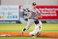 Jeff Kobernus #37 of the Hagerstown Suns tries to turn a double play as Jose Duarte #15 of the Greensboro Grasshoppers slides into second base at NewBridge Bank Park July 30, 2010, in Greensboro, North Carolina.  Photo by Brian Westerholt / Four Seam Images