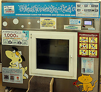The Japanese dog washing machine is demonstrated by a worker, Tokyo, Japan. The washing machine process lasts 33 minutes and costs 500 yen and is regarded as safe and practical, a shampoo is followed by a rinse and blow-dry..22 Feb 2010