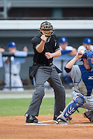 Home plate umpire Grant Hinson makes a strike call during the Appalachian League game between the Bluefield Blue Jays and the Burlington Royals at Burlington Athletic Stadium on June 27, 2016 in Burlington, North Carolina.  The Royals defeated the Blue Jays 9-4.  (Brian Westerholt/Four Seam Images)
