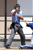Home plate umpire Mario Seneca makes a call during a spring training game between the Philadelphia Phillies and Toronto Blue Jays at the Carpenter Complex on March 16, 2012 in Clearwater, Florida.  (Mike Janes/Four Seam Images)