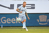 KANSAS CITY, UNITED STATES - AUGUST 25: Johnny Russell #7 of Sporting Kansas City passes the ball  a game between Houston Dynamo and Sporting Kansas City at Children's Mercy Park on August 25, 2020 in Kansas City, Kansas.