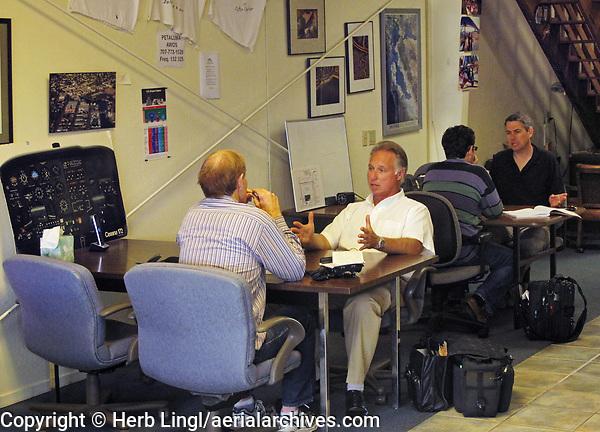 Certified flight instructors Tom Duizendorf and Mark Norquist work with students in the Aeroventure offices, Petaluma Municipal Airport, Petaluma, Sonoma County, California