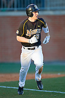 Brannon Champagne #6 of the Missouri Tigers hustles down the first base line against the Charlotte 49ers at Robert and Mariam Hayes Stadium on February 25, 2011 in Charlotte, North Carolina.  Photo by Brian Westerholt / Four Seam Images