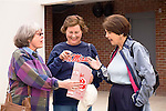 Three mature women with Ole Miss shirt enjoy popcorn at Mississippi University sport stadium in Oxford, Mississippi
